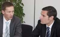 Thomas Surwald, Leiter des Unternehmensbereichs Managed Services von QSC, und QSC-Justiziar Dr. Mario Kaufmann im Gespräch über Service Level Agreements und Kundenzufriedenheit