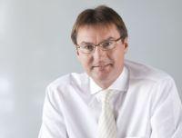 Thomas Stoek, Chef der INFO AG und Vorstand der QSC AG.Thomas Stoek, Chef der INFO AG und Vorstand der QSC AG.
