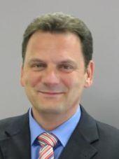 Burt Koberg, QSC AG.