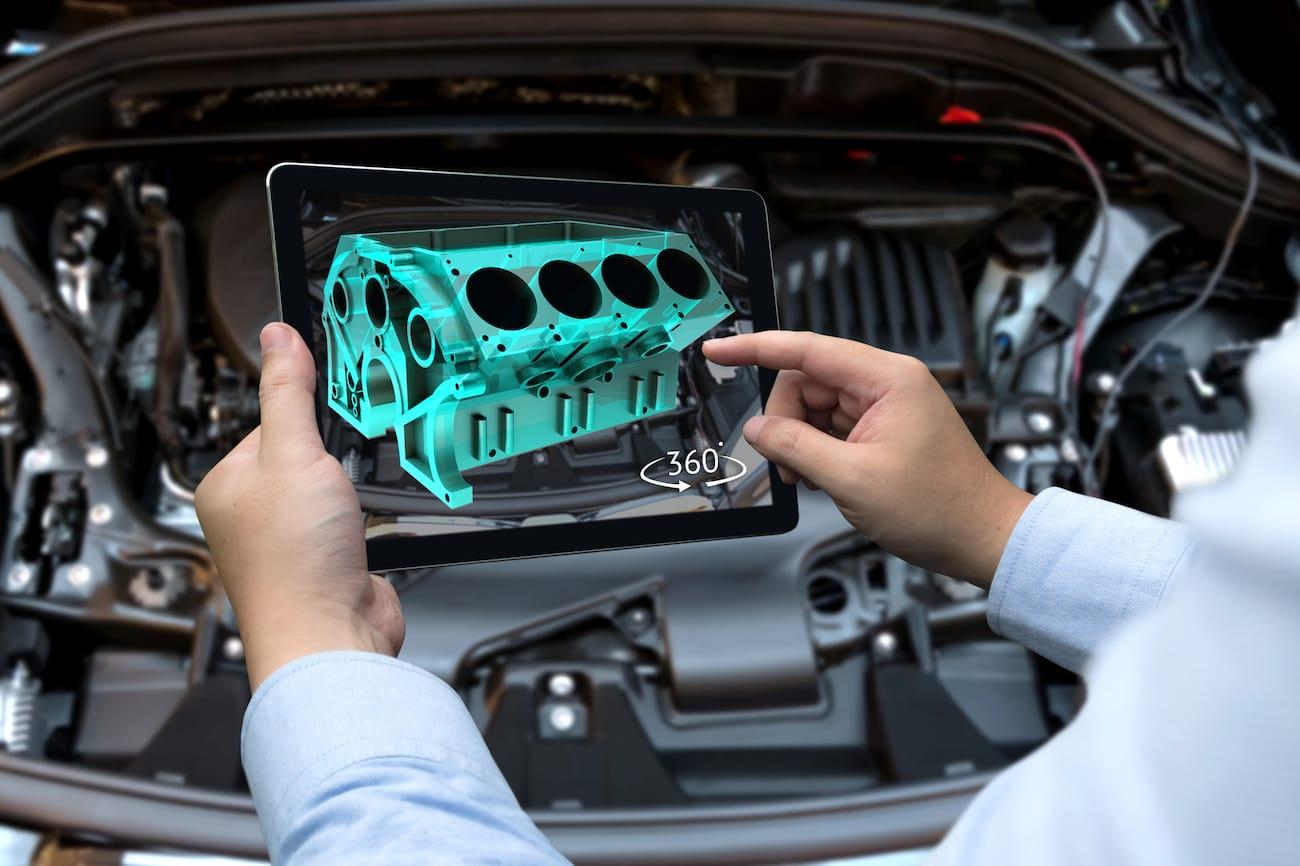 Augmented-Reality-Darstellung eines virtuellen Motors auf einem Tablet
