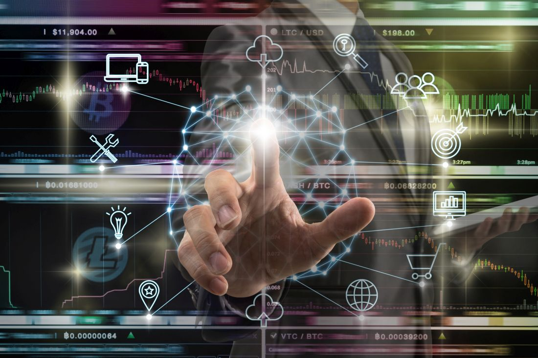 Businessman hand touching the Polygonal brain shape of an artificial intelligence with various icon of smart city Internet of Things Technology over Cryptocurrency Bitcoin exchange trading, AI concept. Foto: © Getty Images / Photographer is my life.