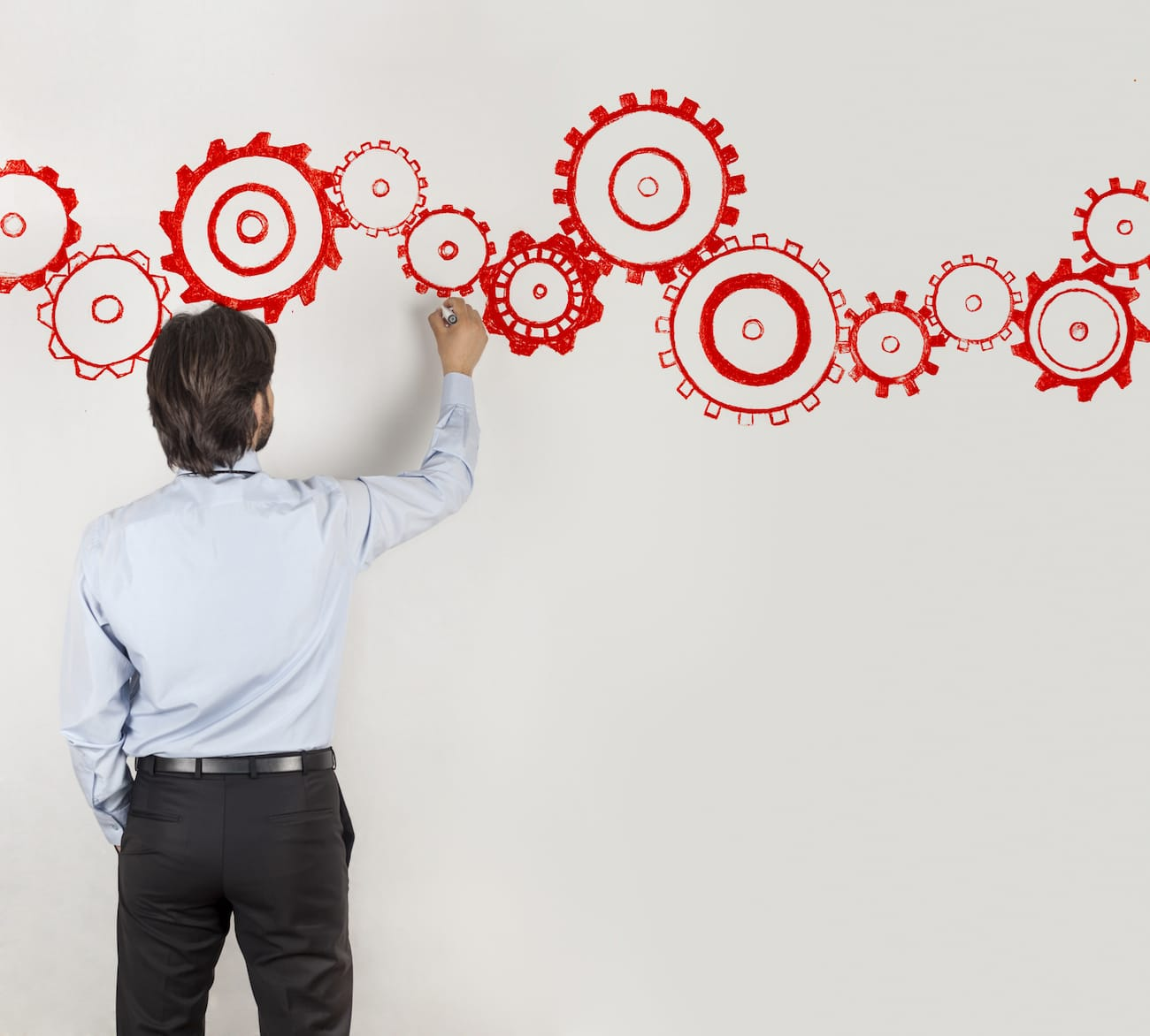 Businessman Drawing Cogs